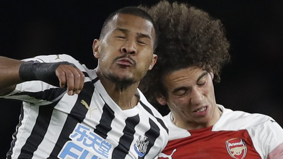 Newcastle's Salomon Rondon, left, competes for the ball with Arsenal's Matteo Guendouzi during the English Premier League soccer match between Arsenal and Newcastle United at Emirates stadium in London, Monday, April 1, 2019. (AP Photo/Kirsty Wigglesworth)