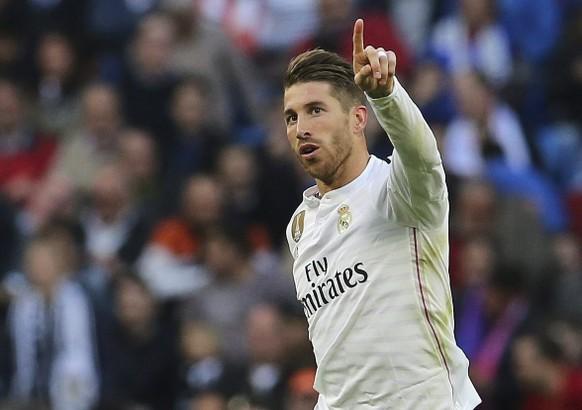 epa04710820 Real Madrid's defender Sergio Ramos celebrates after scoring a goal  during the Spanish Primera Division match between Real Madrid and Malaga at Santiago Bernabeu stadium, in Madrid, Spain 18 April 2015.  EPA/Ballesteros