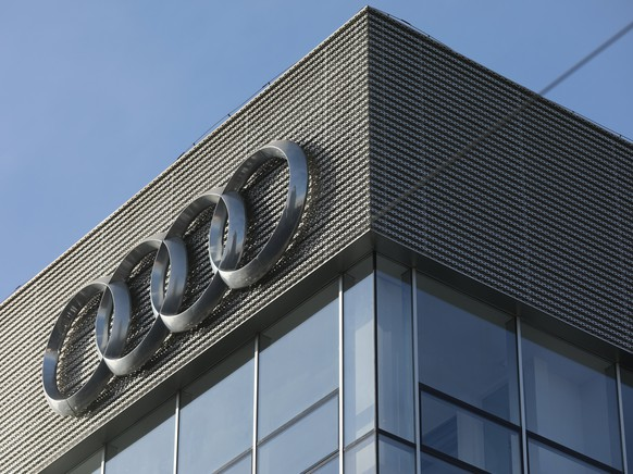 epa06414035 An Audi logo is seen at an Audi auto dealership building in Beijing, China, 03 January 2018. China stopped the production of 553 vehicle models that have not met the government's fuel consumption standards to curb pollution. The policy, which started 01 January 2018, affects vehicles models from such brands as Mercedes-Benz, BMW, Audi, Volkswagen and others.  EPA/WU HONG