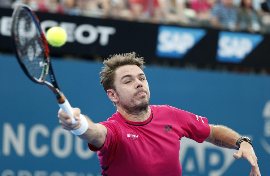 epa05702592 Stan Wawrinka of Switzerland in action against Kei Nishikori of Japan during their semifinal match at the Brisbane International Tennis Tournament in Brisbane, Queensland, Australia, 07 January 2017.  EPA/DAVE HUNT  AUSTRALIA AND NEW ZEALAND OUT