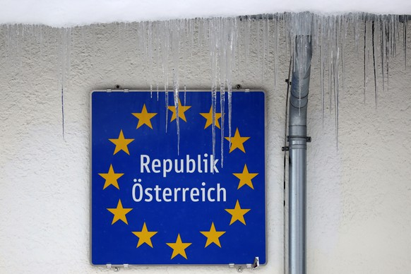 Icicles hang in front of an Austrian border sign at the Italian and Austrian border in Gries am Brenner, Austria, Sunday, Dec. 13, 2020. (AP Photo/Matthias Schrader)