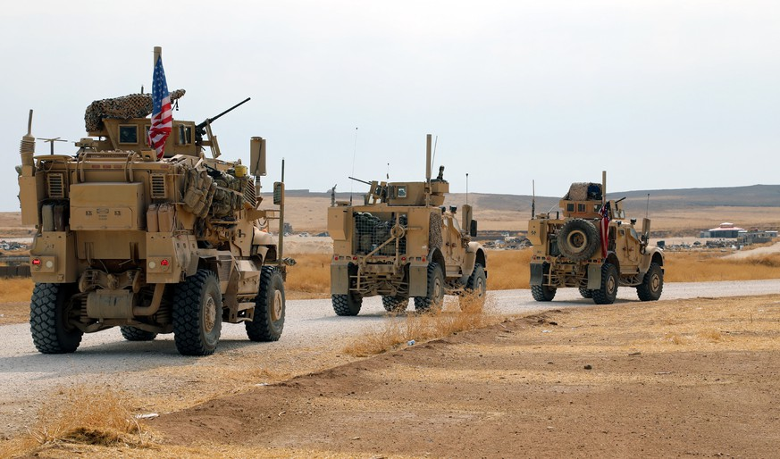 epa07936944 A convoy of US troops head toward the Iraqi borders in northeastern of Syria, 20 October 2019. Media reported the US troops started their withdrawal from north Syria towards Iraq according to agreement between US and Turkey. Turkey has launched an offensive targeting Kurdish forces in north-eastern Syria on 09 October, days after the US withdrew troops from the area.  EPA/AHMED MARDNLI