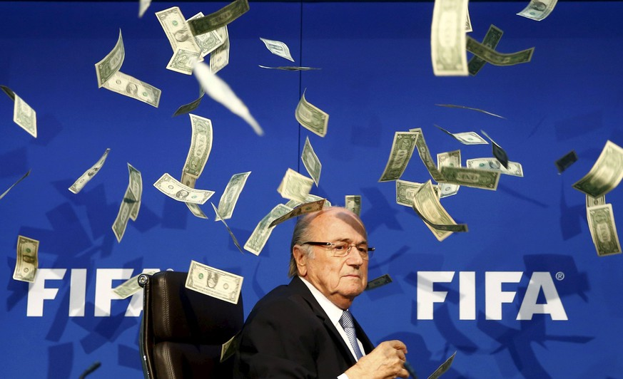 British comedian known as Lee Nelson (unseen) throws banknotes at FIFA President Sepp Blatter as he arrives for a news conference after the Extraordinary FIFA Executive Committee Meeting at the FIFA headquarters in Zurich, Switzerland, in this July 20, 2015 file photo. Blatter faces a 90 day suspension from football if the governing body's Ethics judge backs a prosecutor's recommendation, a close friend and former advisor to Blatter told Reuters on October 7, 2015. Blatter's long-term confidant Klaus Stoehlker said the decision by judge Hans-Joachim Eckert was expected by October 9. Reuters was unable to confirm the information with FIFA's Ethics Committee or with FIFA itself. REUTERS/Arnd Wiegmann/Files      TPX IMAGES OF THE DAY