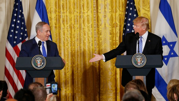 FILE PHOTO --  U.S. President Donald Trump (R) reaches to greet Israeli Prime Minister Benjamin Netanyahu after a joint news conference at the White House in Washington, U.S., February 15, 2017.   REUTERS/Kevin Lamarque/File Photo