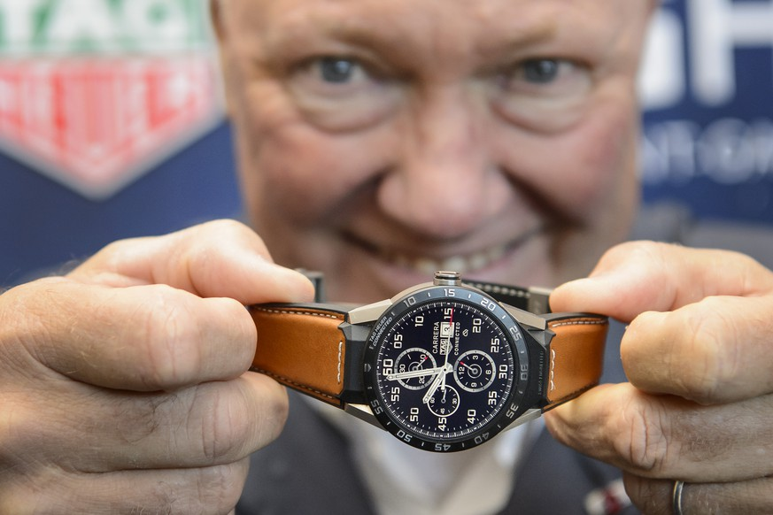 TAG Heuer CEO and President of LVMH Watch Division, Jean-Claude Biver, poses with the new titanium Carrera Connected watch during a press event at the TAG Heuer headquarters, in La Chaux-de-Fonds, Switzerland, Thursday, December 3, 2015. (KEYSTONE/Jean-Christophe Bott)