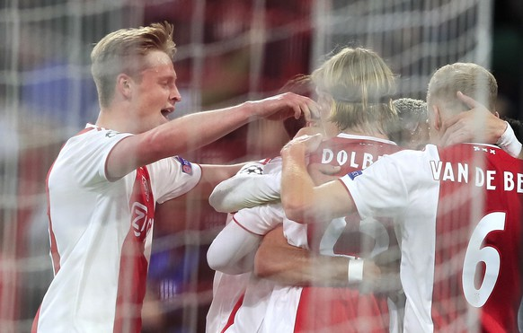 Ajax's players celebrate after scoring their second goal during the Champions League semifinal second leg soccer match between Ajax and Tottenham Hotspur at the Johan Cruyff ArenA in Amsterdam, Netherlands, Wednesday, May 8, 2019. (AP Photo/Peter Dejong)