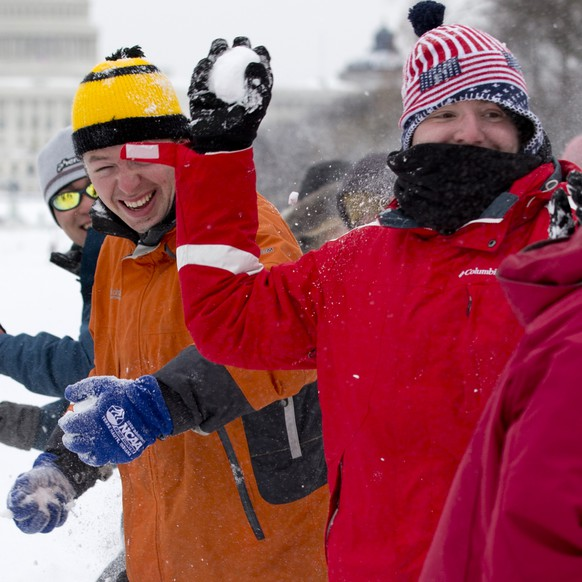 With the Capitol in the background, snowball fighters attack each other with snow on the National Mall in Washington, Monday, March 3, 2014, during a snowball fight hosted by the Washington DC Snowball Fight Association. Winter kept its icy hold on much of the country Monday, with snow falling and temperatures dropping as schools and offices closed and people from the South and Mid-Atlantic to Northeast reluctantly waited out another storm indoors. Four to 8 inches of snow were forecast from Baltimore to Washington _ lower than earlier predictions but enough to cause headaches for the region.  (AP Photo/Carolyn Kaster)