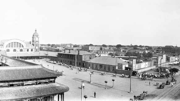 View of legation quarter, Peiping (Beijing) from top of hotel Des Wagon-Lits. in the distance, June 17, 1935. On the  right is shown the renowned Forbidden City, while on the left, in the distance, may be seen the towering wireless masts of the American Army and the American legation .(AP Photo)
