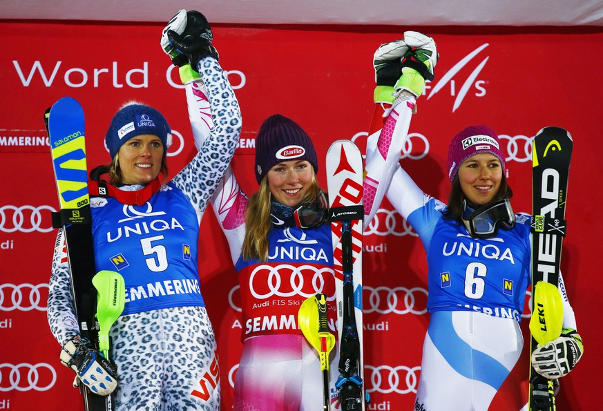 From left, Slovakia's Veronika Velez Zuzulova, second placed, the winner Mikaela Shiffrin, of the United States, and third placed Wendy Holdener, of Switzerland, celebrate on podium after an alpine ski, women's World Cup slalom in Semmering, Austria, Thursday, Dec. 29, 2016. (AP Photo/Giovanni Auletta)