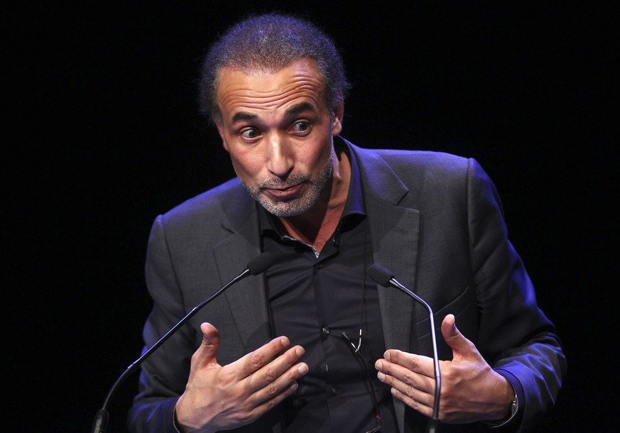 FILE - In this Feb.7 2016 file photo, Muslim scholar Tariq Ramadan delivers a speech during a French Muslim organizations meeting in Lille, northern France. A judicial official says Wednesday Jan. 31 2018 Ramadan has been placed in custody by French police over allegations of rape and sexual assault. (AP Photo/Michel Spingler, File)