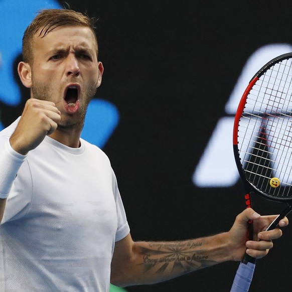 Britain's Daniel Evans celebrates a point win over Australia's Bernard Tomic during their third round match at the Australian Open tennis championships in Melbourne, Australia, Friday, Jan. 20, 2017. (AP Photo/Kin Cheung)