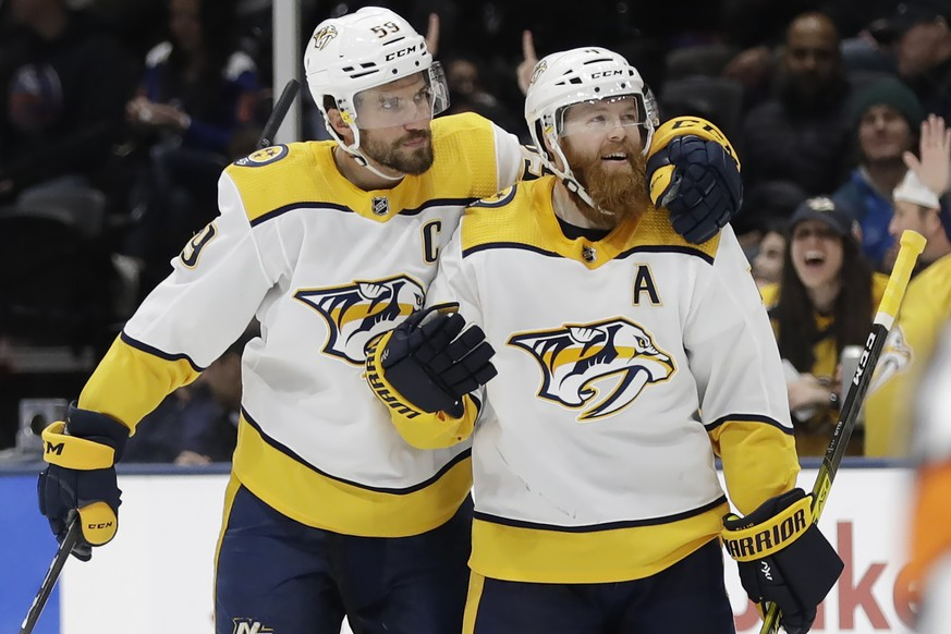 Nashville Predators' Roman Josi, left, celebrates with Ryan Ellis after scoring a goal during the third period of an NHL hockey game against the New York Islanders Tuesday, Dec. 17, 2019, in Uniondale, N.Y. The Predators won 8-3. (AP Photo/Frank Franklin II)