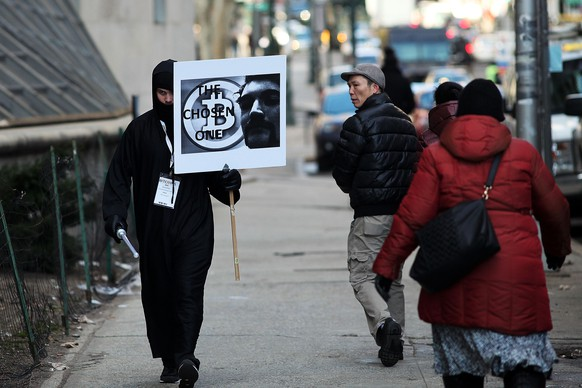 NEW YORK, NY - JANUARY 13: Max Dickstein walks with other supporters of Ross Ulbricht, the alleged creator and operator of the Silk Road underground market, in front of a Manhattan federal court house on the first day of jury selection for his trial on January 13, 2015 in New York City. Ulbricht, who has pleaded not guilty, is accused by the US government of making millions of dollars from the Silk Road website which sold drugs and other illegal commodities anonymously.   Spencer Platt/Getty Images/AFP== FOR NEWSPAPERS, INTERNET, TELCOS & TELEVISION USE ONLY ==