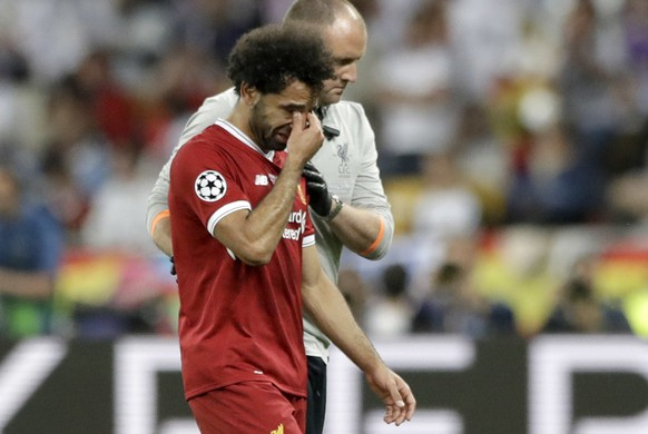 Liverpool's Mohamed Salah leaves after injuring himself during the Champions League Final soccer match between Real Madrid and Liverpool at the Olimpiyskiy Stadium in Kiev, Ukraine, Saturday, May 26, 2018 (AP Photo/Matthias Schrader)