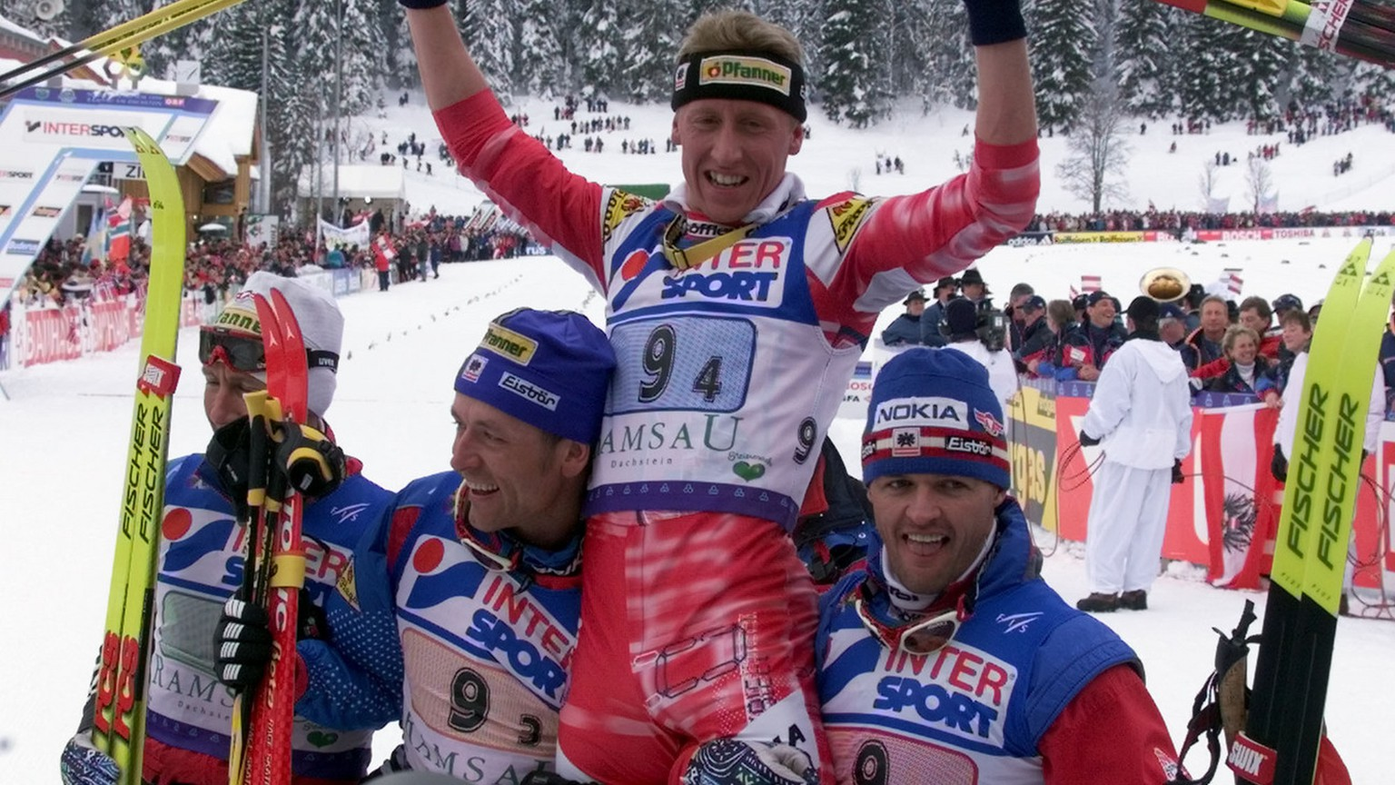 From left,  of Austria celebrate after winning the men's 4x10-kilometres cross country relay at the Nordic Ski World Championship in Ramsau, Austria, Friday February 26, 1999. (AP Photo/Frank Augstein)