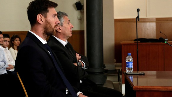 Barcelona's Argentine soccer player Lionel Messi (L) sits in court with his father Jorge Horacio Messi during their trial for tax fraud in Barcelona, Spain, June 2, 2016. REUTERS/Alberto Estevez/Pool/Files