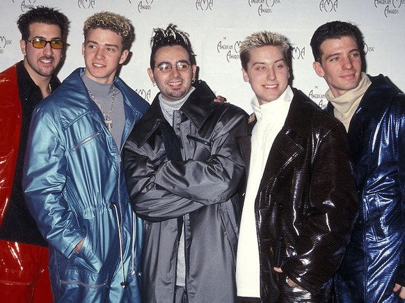 LOS ANGELES - JANUARY 11:   Pop group NSYNC: Joey Fatone, Justin Timberlake, Chris Kirkpatrick, Lance Bass and JC Chasez attend the 26th Annual American Music Awards on January 11, 1999 at the Shrine Auditorium in Los Angeles, California. (Photo by Ron Galella, Ltd./WireImage) *** Local Caption *** NSYNC