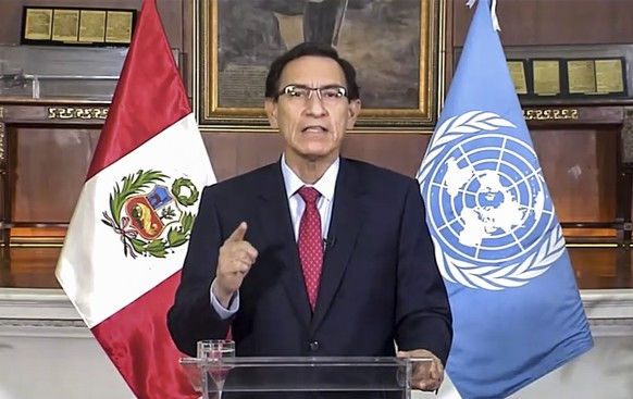 In this image made from UNTV video, Peru President Martín Vizcarra Cornejo speaks in a pre-recorded message which was played during the 75th session of the United Nations General Assembly, Tuesday, Sept. 22, 2020, at U.N. headquarters in New York. The U.N.'s first virtual meeting of world leaders started Tuesday with pre-recorded speeches from some of the planet's biggest powers, kept at home by the coronavirus pandemic that will likely be a dominant theme at their video gathering this year. (UNTV via AP)