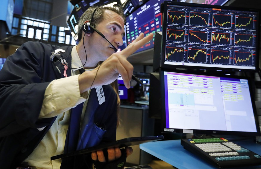 FILE - In this July 30, 2019 file photo, trader Gregory Rowe works on the floor of the New York Stock Exchange. An economic alarm bell is sounding in the U.S. and sending warnings of a potential recession..Yields on 2-year and 10-year Treasury notes inverted early Wednesday, Aug. 14, a market phenomenon that shows investors want more in return for short-term government bonds than they are for long-term bonds. (AP Photo/Richard Drew) Gregory Rowe