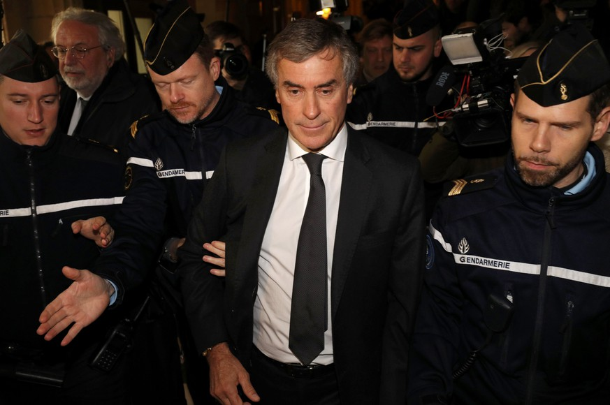 REFILE WITH CORRECTING HEADLINEFormer French budget minister Jerome Cahuzac, who resigned in 2013 after he admitted to having a Swiss bank account, is surrounded by French gendarmes as he leaves after the verdict in his tax fraud trial at the courtroom in Paris, France, December 8, 2016. Cahuzac was sentenced to three years in jail on Thursday for hiding an offshore bank account of his own.  REUTERS/Philippe Wojazer  TPX IMAGES OF THE DAY