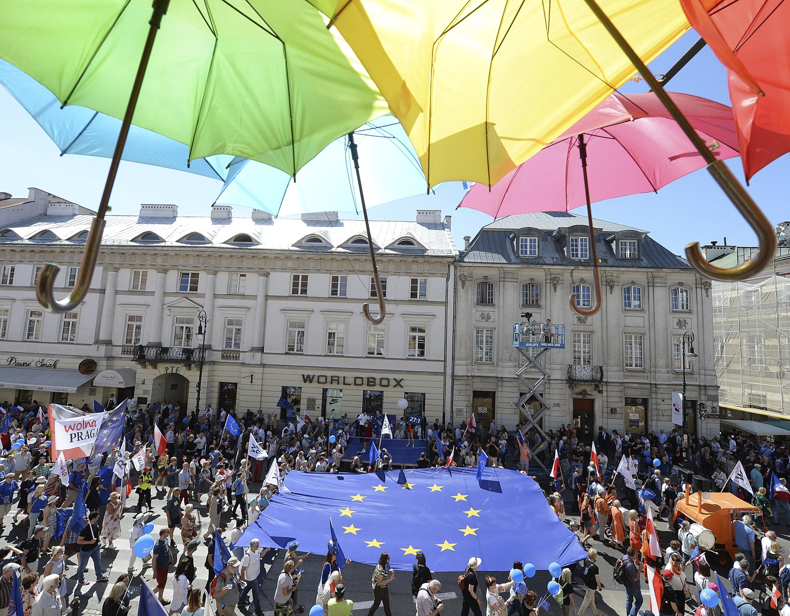 People hold a European flag as they take part in a demonstration during an anti-government protest, called 'Freedom March' and organized by opposition parties, in Warsaw, Poland, Saturday, May 12, 2018. (AP Photo/Czarek Sokolowski)