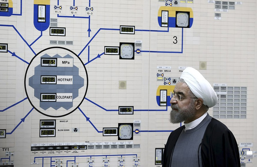 FILE - In this Jan. 13, 2015, file photo released by the Iranian President's Office, President Hassan Rouhani visits the Bushehr nuclear power plant just outside of Bushehr, Iran. Rouhani is reportedly set to announce ways the Islamic Republic will react to continued U.S. pressure after President Donald Trump pulled America from Tehran's nuclear deal with world powers. Iranian media say Rouhani is expected to deliver a nationwide address as soon as Wednesday, May 8, 2019, regarding the steps the country will take. (AP Photo/Iranian Presidency Office, Mohammad Berno, File)
