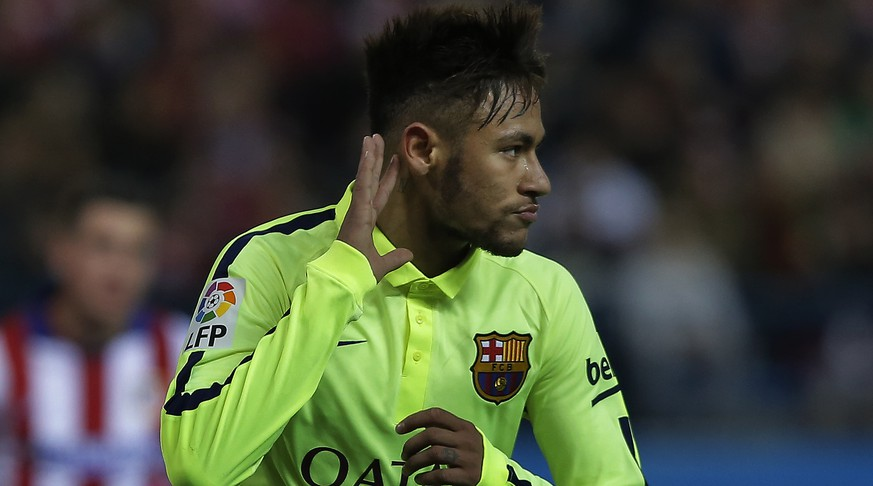 Barcelona's Neymar, centre, celebrates his second goal during a second leg quarterfinal Copa del Rey soccer match between Atletico de Madrid and FC Barcelona at the Vicente Calderon stadium in Madrid, Spain, Wednesday, Jan. 28, 2015. (AP Photo/Andres Kudacki)