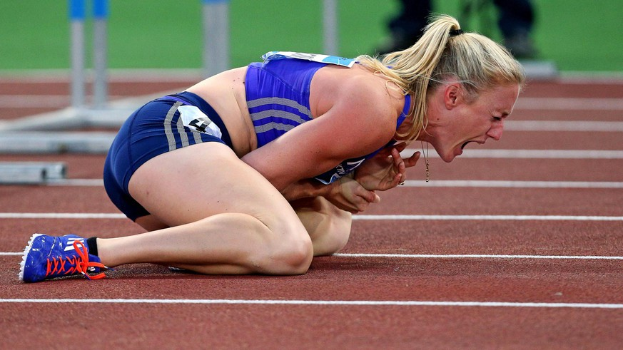 Sally Pearson shouts in pain after hitting an obstacle during the women's 100 hurdles event, at the Golden Gala IAAF athletic meeting, in Rome's Olympic stadium, Thursday, June 4, 2015. Olympic champion Pearson of Australia was injured after hitting the fifth obstacle in the 100 hurdles. She was carried off on a stretcher after getting attention to her left wrist area. (Alessandro Di Meo/ANSA via AP)