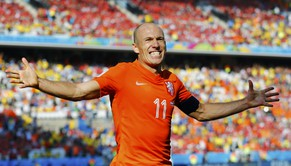 Arjen Robben of the Netherlands celebrates the team's second goal scored by Memphis Depay (not pictured) during their 2014 World Cup Group B soccer match against Chile at the Corinthians arena in Sao Paulo June 23, 2014. Robben assisted with a pass. REUTERS/Ivan Alvarado (BRAZIL  - Tags: SOCCER SPORT WORLD CUP)     TOPCUP