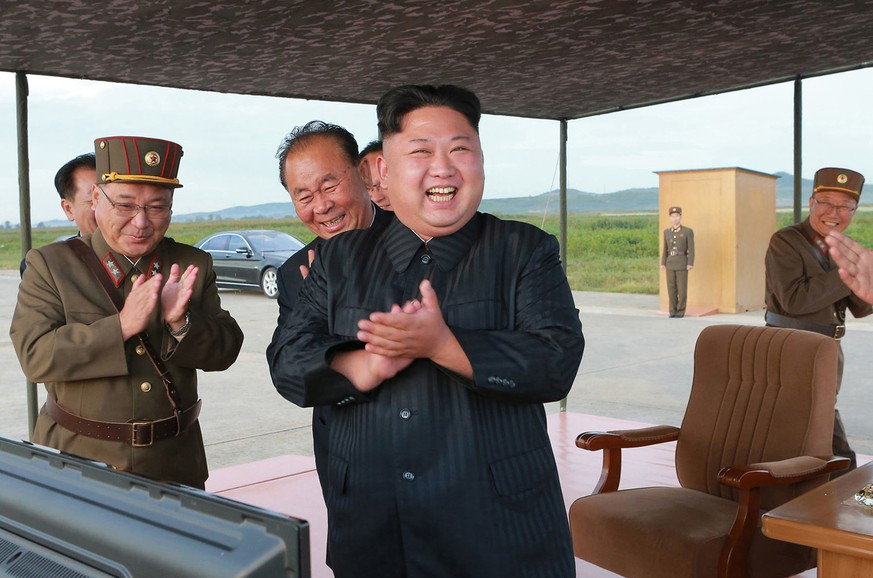 In this undated file photo distributed on Saturday, Sept. 16, 2017, by the North Korean government, North Korean leader Kim Jong Un, center, celebrates what was said to be the test launch of an intermediate range Hwasong-12 missile at an undisclosed location in North Korea. Independent journalists were not given access to cover the event depicted in this image distributed by the North Korean government. The content of this image is as provided and cannot be independently verified. (Korean Central News Agency/Korea News Service via AP, File)