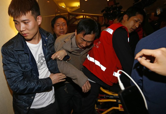 epa04139022 Relatives of passengers of the missing Malaysia Airlines flight MH370 react after watching a news broadcast from Kuala Lumpur, at hotel in Beijing, China, 24 March 2014. Malaysian Prime Minister Najib Razak announced that Malaysian missing airlines MH370 has ended in south Indian Ocean. The Beijing-bound Malaysian Airlines flight MH 370, a Boeing 777-200 carrying 239 people on board, disappeared from the radar on 08 March after it took off from the Kuala Lumpur International Airport.  EPA/ROLEX DELA PENA