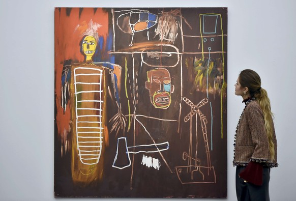 'Air Power' by Jean-Michel Basquiat, with an estimate of ?2.5 million - ?3.5 million, part British pop star David Bowie's  collection, is exhibited in a press view at Sotheby's auction house, in central London, Britain November 1, 2016. The auction house will stage a three-part sale entitled  Bowie/Collector, which includes 350 works from Bowie' s private collection.    REUTERS/Hannah McKay