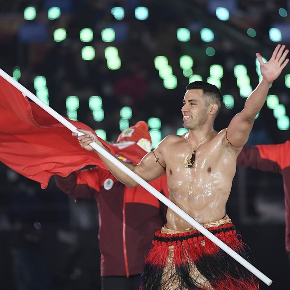 epa06508524 Team Tonga with flag bearer Pita Taufatofua arrive at the Opening Ceremony of the PyeongChang 2018 Olympic Games at the Olympic Stadium, Pyeongchang county, South Korea, 09 February 2018.  EPA/FILIP SINGER