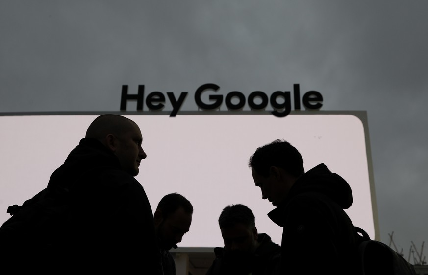 People stand in front of the Google tent during preparations for CES International, Saturday, Jan. 5, 2019, in Las Vegas. (AP Photo/John Locher)