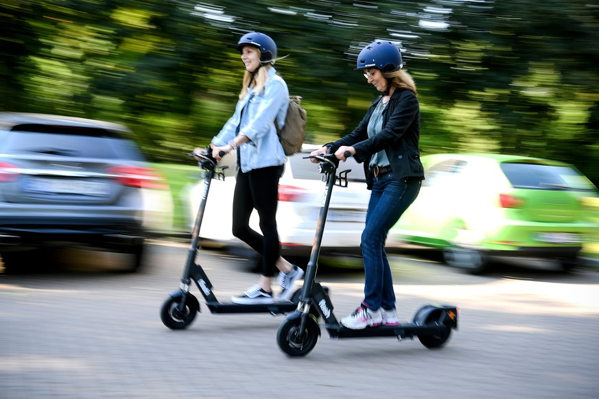 epa07627037 Women ride an CIRC e-scooter (former FLASH) in Herne, Germany, 05 June 2019. Even before electric pedal-scooters are allowed nationwide on 15 June, a first provider will start a rental service in the Ruhr area. In the city of Herne, several dozens of electric scooters are to be put on the road from 05 June with the permission of local authorities.  EPA/SASCHA STEINBACH