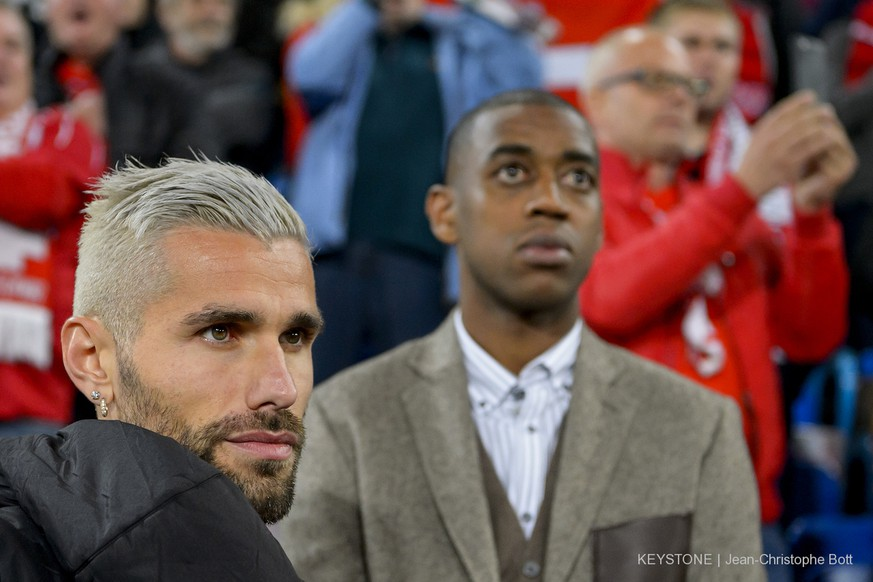 Switzerland's Valon Behrami, left, and Switzerland's, Gelson Fernandes, right, react during the 2018 Fifa World Cup Russia group B qualification soccer match between Switzerland and Hungary in the St. Jakob-Park stadium in Basel, Switzerland, on Saturday, October 7, 2017. (KEYSTONE/Jean-Christophe Bott)