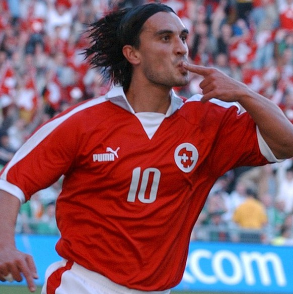 Swiss Hakan Yakin celebrates his goal for 1:0 during the EURO 2004 qualifyer between Switzerland and Ireland, at St. Jakob Park in Basel, Switzerland, Saturday, October 11, 2003. (KEYSTONE/Walter Bieri)