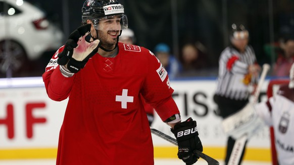 Switzerland forward Denis Hollenstein celebrates a goal during the Group B preliminary round match between Switzerland and Latvia at the Ice Hockey World Championship in Minsk, Belarus, Tuesday, May 20, 2014. (AP Photo/Darko Bandic)