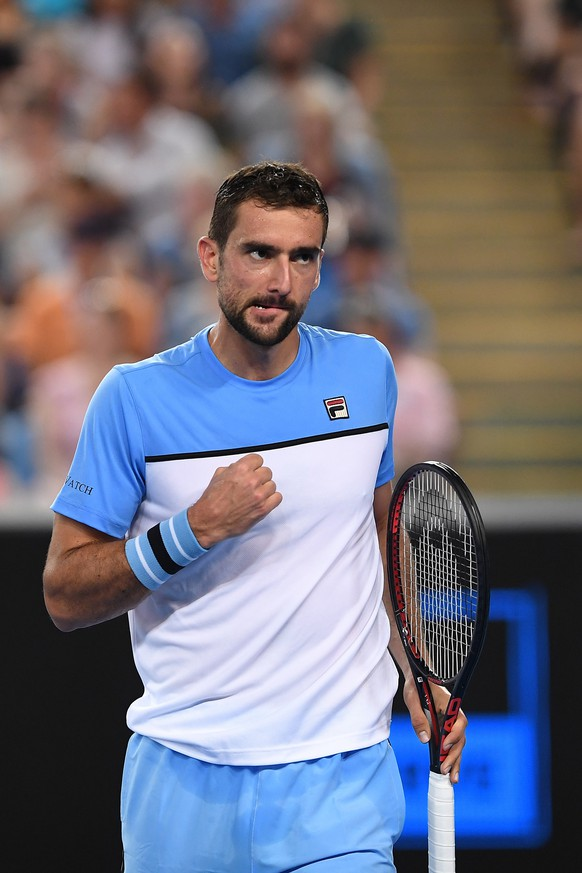 epa07282438 Marin Cilic of Croatia reacts during his men's singles first round against Bernard Tomic of Australia at the Australian Open tennis tournament in Melbourne, Australia, 14 January 2019.  EPA/LUKAS COCH AUSTRALIA AND NEW ZEALAND OUT