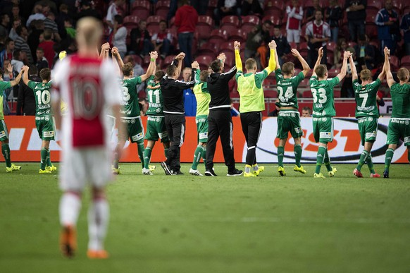 epa04872210 Rapid Vienna players celebrate after the UEFA Champions League third qualifying round second leg football match between Ajax vs Rapid Boys (2-3) on August 4, 2015 at Amsterdam ArenA Stadium in The Netherlands.  EPA/OLAF KRAAK