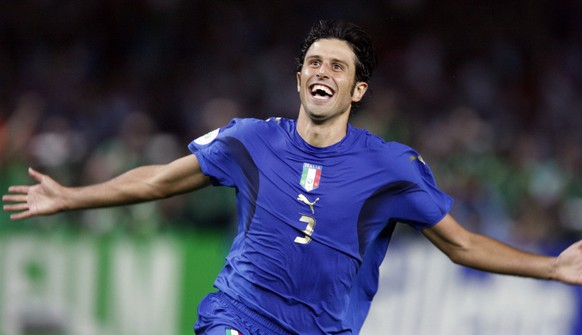 Italy 's Fabio Grosso reacts after scoring the winning goal in a penalty shootout against France in the final of the soccer World Cup between Italy and France in the Olympic Stadium in Berlin, Sunday, July 9, 2006.  (AP Photo/Luca Bruno)  ** MOBILE/PDA USAGE OUT **