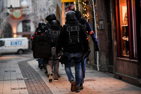 epa07225135 Members of the French National Police BRI (Research and Intervention Brigade) during their search for a suspect following a deadly shooting that took place at a Christmas market in Strasbourg, France, 12 December 2018. According to reports, three people were killed and 12 others were wounded after a gunman opened fire at a popular Christmas market in Strasbourg on 11 December evening. Hundreds of police officers are hunting the suspect, who is at large and said to be known to security services. The motive of the attack is yet unclear.  EPA/PATRICK SEEGER