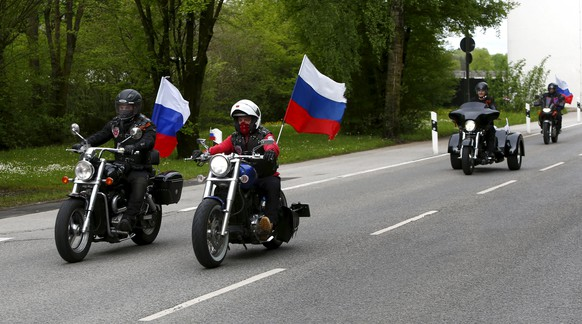 Members of the Russian motorcycle group called 'Nachtwoelfe' (Night Wolves) arrive at the former German Nazi concentration camp in Dachau near Munich, Germany May 4, 2015. Some 50 members of the Night Wolves, a motorcycle group blacklisted by the United States for taking part in Russia's annexation of Crimea, are taking part in a bike ride from Moscow to Berlin, commemorating the end of World War Two.    REUTERS/Michaela Rehle