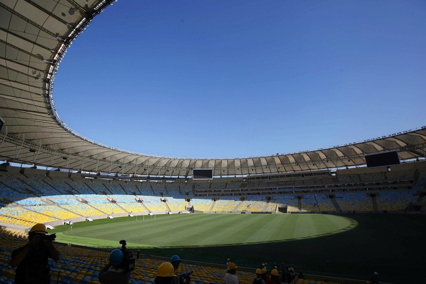 epa04141884 Picture taken on 15 May 2013 shows an interior view of the Estadio do Maracana in Rio de Janeiro, Brazil. Once the largest stadium in the world, packing in crowds of up to 200,000, the Maracana now has an official capacity of 76,804 spectators and still remains Brazil's biggest soccer ground. Rio de Janeiro is one of the host cities of the FIFA World Cup 2014 hosting four matches in the tournament's group phase, one round of 16, one quarter final and the final match on 13 July 2014. The 20th FIFA World Cup will take place in Brazil from 12 June to 13 July 2014.  EPA/MARCELO SAYAO *** Local Caption *** 50624017
