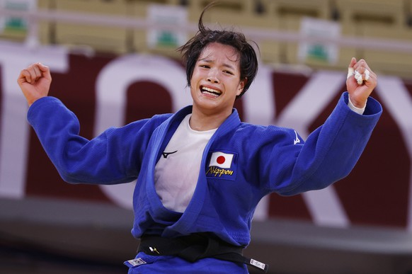 epa09364358 Uta Abe of Japan reacts after defeating Amandine Buchard of France during their bout in the Women's -52kg Final Judo events of the Tokyo 2020 Olympic Games at the Nippon Budokan arena in Tokyo, Japan, 25 July 2021.  EPA/JEON HEON-KYUN