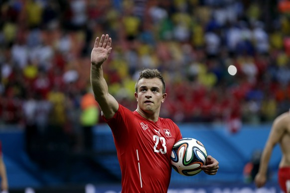 Switzerland's Xherdan Shaqiri salutes as he carries the ball after scoring a hat-trick during the group E World Cup soccer match between Honduras and Switzerland at the Arena da Amazonia in Manaus, Brazil, Wednesday, June 25, 2014. Switzerland won 3-0.(AP Photo/Felipe Dana)