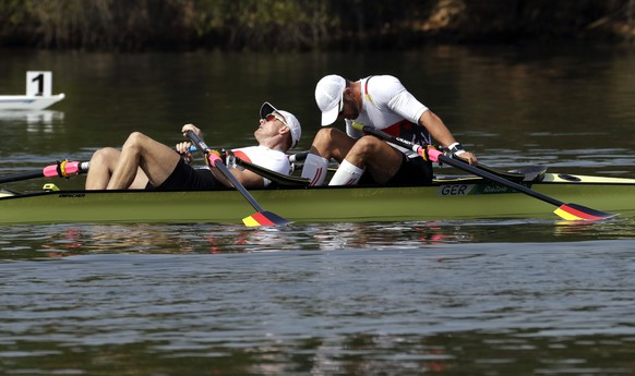 Marcel Hacker and Stephan Krueger, of Germany, rest after competing in the men's rowing double sculls semifinal heat during the 2016 Summer Olympics in Rio de Janeiro, Brazil, Tuesday, Aug. 9, 2016. (AP Photo/Andre Penner)