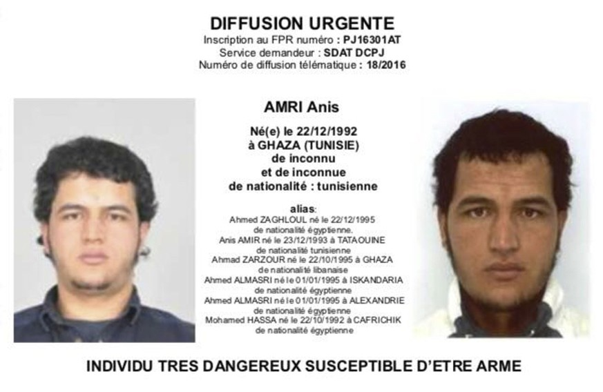 The photo which was sent to European police authorities and obtained by AP on Wednesday, Dec. 21, 2016 shows Tunisian national Anis Amri who is wanted by German police for an alleged involvement in the Berlin Christmas market attack.  The Tunisian man suspected of driving a truck into a crowded Christmas market in Berlin was killed early Friday Dec. 23, 2016 in a shootout with police in Milan, ending a Europe-wide manhunt, Italy's interior minister said. (Police via AP)