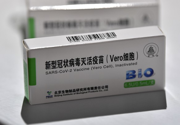 epa09178929 A box with a dose of the Chinese Sinopharm vaccine against COVID-19 lays on a table during a mass vaccination campaign at the Boris Trajkovski Arena in Skopje, Republic of North Macedonia, 05 May 2021. North Macedonia begin mass vaccination after the arrival of 200 000 doses of the Chinese Sinopharm COVID-19 vaccine. The European Union started delivering EU-funded coronavirus vaccines to the Western Balkans countries, candidates to join EU, but China and Russia have already been supplying the much-needed vaccines to the region.  EPA/GEORGI LICOVSKI