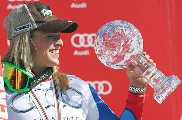 Switzerland's Lara Gut shows the crystal globe trophy of the women's alpine skiing Super-G at the World Cup finals in Lenzerheide, Switzerland, Thursday, March 13, 2014. (AP Photo/Armando Trovati)